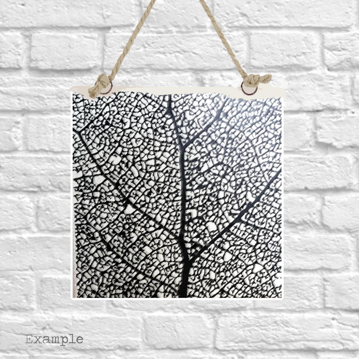 Pre-set-wall-hanging-background-black-leaf